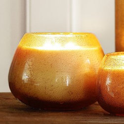 """Amber Bubble Glass Scented Candlepot, Large - Our Bubble Candle Pot is a relaxing, fragrant companion for a bubble bath. Small: 4.25"""" diameter, 4"""" high Large: 7"""" diameter, 5.5"""" high Blown bubble glass Filled with citrus-scented paraffin wax with lead-free wick."""