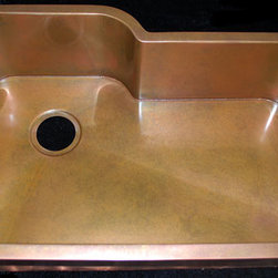 Custom copper kitchen sink to replace existing sink - This is a very common replacement sink for Kohler, Elkay, Blanco and Franke double bowl undermount sinks (which all happen to be obsolete designs). This is a very expensive sink for us to manufacture. The bottom is one piece, the side is welded to the bottom, both inside and out. Then, the flange is welded to the side, both inside and out. This sink requires about 5 times the labor of an apron front sink. Figure approximately $4200 for a sink like this one. This type of sink is very difficult to build. We have to weld the bottom to the sides (inside and out) and the top flange has to be welded to the sides (inside and out). There is about 5 times the labor in building a sink like this, verses a standard rectangular sink. If you want to get rid of your existing sink and keep your countertop, this option offers a great sink, a perfect fit and a less expensive alternative to replacing granite tops. We make sinks like this all the time. Our customers send us a template in the mail and we build the sink to the exact size of the template. We can walk you through the process. Several customers have expressed initial concern about our sink fitting properly, however - every sink we have sent has fit PERFECTLY!