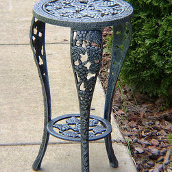 Oakland Living - Oakland Living Vineyards Wrought Iron Planter - Our plant table stands are the perfect addition to any setting bringing beauty and style both indoors and out. Constructed of durable cast iron with interchangeable top this grape table plant stand features a hardened powder coated finish for years of beauty. The Oakland vineyard collection is perfect for fruit and wine lovers alike. Each piece is adorned with twisty grape vines and ripe clusters of grapes. The attractive grape vines will add beauty and style to any outdoor patio garden setting. Each piece is hand cast and finished for the highest quality possible.For more than 15 years Oakland Living has been making wrought iron aluminum and resin wicker patio furniture and has built a reputation around their quality construction and superior value. Their furniture is made to weather even the most inclement conditions and stay looking good year after year. Because their items are warehoused here in the U.S. you will enjoy quick shipping on all your patio furniture purchases. Features include Easy to Follow Assembly Instructions and Product Care Information Metal Hardware Some Assembly Required 1 Year Limited Manufacturers Warranty Other Items Available in Collection We recommend that the products be covered to protect them when not in use. To preserve the beauty and finish of the metal products we recommend applying an epoxy clear coat once a year. However because of the nature of iron it will eventually rust when exposed to the elements..