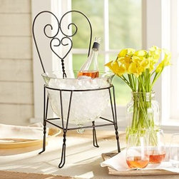 """Wire Chair & Glass Party Bucket - Fashioned after chairs common in 1950s ice cream parlors, this chair is a nostalgic way to serve present-day party beverages. 13"""" wide x 11"""" deep x 23"""" high Iron frame with blown-glass bowl."""