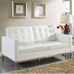 Florence Style White Leather Loft Loveseat - The Leather Loft Loveseat offers a stunning and luxurious look that will instantly enhance any space. This mid-century modern leather love seat is inspired by the designs of Florence Knoll 1954 lounge collection, and has a recognizable mid-century modern style.The simple style of the Loft Loveseat in leather upholstery makes for a clean, sharp look. Tufted accents create a beautiful pattern, and the couch's low profile makes the loft sofa an ideal item small space. Features a polished stainless steel frame, and high quality leather cushions that attach by velcro to the back.This item is a high quality reproduction of the original.
