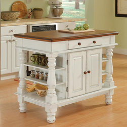 Home Styles - Home Styles Americana Kitchen Island - 5094-94 - Shop for Kitchen Islands from Hayneedle.com! The Home Styles Americana Kitchen Island is a stunning rustic piece with strong lines raised panel doors and hand-applied antique white sanded and distressed finish. Crafted from hardwood solids and engineered wood with a distressed oak finished top and matching oak finished knobs the Americana Kitchen Island is highly decorative but also highly functional. This island features an easy-glide pass-through drawer double door storage cabinet and open storage shelving on each end for a plethora of storage options great for spices cook books utensils cooking equipment and more. Measures 42W x 24D x 36H inches.About Home StylesHome Styles is a manufacturer and distributor of RTA (ready to assemble) furniture perfectly suited to today's lifestyles. Blending attractive design with modern functionality their furniture collections span many styles from timeless traditional to cutting-edge contemporary. The great difference between Home Styles and many other RTA furniture manufacturers is that Home Styles pieces feature hardwood construction and quality hardware that stand up to years of use. When shopping for convenient durable items for the home look to Home Styles. You'll appreciate the value.