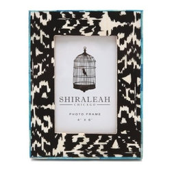 Gift Boutique Hand-Painted Picture Frame - One thing I need more of in my home is graphic picture frames. This black and white ikat frame with bone tile inlay would be the star of my night table.