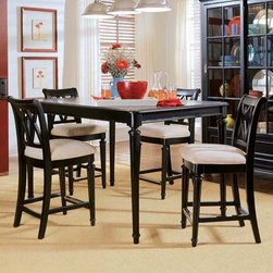 "American Drew Camden Black 5 pc. Counter Height Table Set - Create a comfortable and stylish place to enjoy good food and good company with theAmerican Drew Camden Black 5 pc. Counter Height Table Set. This beautiful set is crafted from hardwood solids and features a distinctive Ebony finish. It includes a counter-height table that comfortably seats 4. Counter height chairs feature thick padded seat cushions and soft tan upholstery. About American DrewFounded in 1927 American Drew is a well-established leading manufacturer of medium- to upper-medium-priced bedroom dining room and occasional furniture. American Drew's product collections cover a broad variety of style categories including traditional transitional and contemporary. Their collections range from the legendary 18th-century traditional """"Cherry Grove """" celebrating its 42nd year of success to the extremely popular """"Bob Mackie Home Collection """" influenced by the world-renowned fashion designer Bob Mackie. """"Jessica McClintock Home"""" features another beloved designer bringing unique style to an American Drew line. American Drew's headquarters are located in Greensboro N.C. Their products are distributed through thousands of independently owned retailers throughout the United States and Canada and around the world."