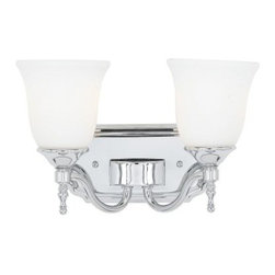 Quoizel Tritan TT8602C Bath Fixture - 13W in. - Polished Chrome - The Quoizel Tritan TT8602C Bath Fixture - 13W in. - Polished Chrome has an elegant simplicity that's stylish in a wide variety of bath settings. The steel frame is finished in a shiny polished chrome, while the glass shades have an eye-catching bell shape. It's a classic design for a classic ambiance everyone will love. You'll just need to add two 100-watt medium base bulbs (not included).About Quoizel LightingLocated in Charleston, South Carolina, Quoizel Lighting has been designing timeless lighting fixtures and home accessories since 1930. They offer a distinctive line of over 1,000 styles, including chandeliers, lamps, and hanging pendants. Quoizel Lighting is the perfect way to add an inviting atmosphere to any area in your home, both indoors and out.
