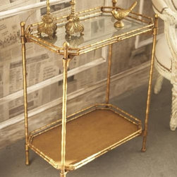 Bamboo Two-Tier Antiqued Mirror Table - This gold, faux bamboo, two-tier table makes a very elegant small chinoiserie-style bar. Constructed of gilded metal and antiqued, mirrored glass, it is foldable and the top tray is removable to use as a serving tray.