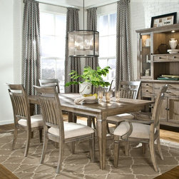 Legacy Classic Furniture - Legacy Brownstone Village 7 Piece Dining Table Set with Slat Back Chairs - LGC12 - Shop for Dining Sets from Hayneedle.com! A little bit country a little bit contemporary but always utterly charming the Legacy Brownstone Village 7 Piece Dining Table Set with Slat Back Chairs is the perfect way to introduce contemporary rustic style to your new or redesigned dining room. This beautifully crafted set is made from rubberwood solids and oak veneers in an aged patina finish and features a plank-style country tabletop slat back chairs with top cutouts and a richly colored cream fabric of rayon polyester and cotton.About Legacy Classic FurnitureCommitted to offering the best of today's youth-bedroom styles for the young and young at heart Legacy Classic Furniture offers a wide selection of best selling designs and finishes with a large variety of beds and storage and study options. Dedicated to providing outstanding quality at reasonable prices Legacy Classic Furniture employs quality materials proven construction techniques and the highest safety standards to manufacture exceptional products that are built to last a lifetime.Note about drawer features:All Legacy products use Kenlin's Rite-Trak drawer guide system. Exceptionally quiet and smooth this system features positive stops and close tolerances for better drawer fit. Kenlin drawer guides are made with precision steel guides and runners permanent lubrication and specially engineered plastic components for years of reliable performance.