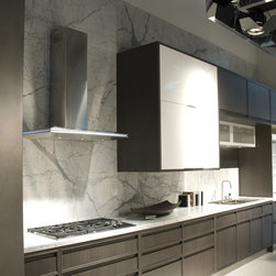 """36"""" Solaris Wall - Designer stainless steel luxury range hood with unique shape and LED accent light strip."""