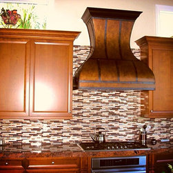 Custom Copper Range Hood - Rustic style copper range hood with steel straps.