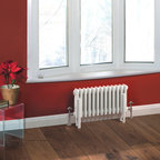 Hudson Reed - Traditional Column Radiator Heater Cast Iron Style White 11.8 x 23 - Hudson Reed Traditional 13 x 3 Column Radiator Cast Iron Style White 11.8 x 23 This cast iron style radiator, with a high quality white powder coat finish (RAL 9016), has 13 vertical triple columns that give an outstanding heat output of 533 Watts (1,817 BTUs), enough to warm a room quickly and effectively.When combined with a set of modern valves, this up-to-date version of a classic radiator design is an ideal complement to contemporary settings, but also fits in well with traditional décor. This versatile radiator is compatible with all domestic central heating systems, will connect with your existing pipe work and is supplied complete with a wall mounting kit. For a truly authentic look, combine this traditional-style radiator with a Hudson Reed floor mounting kit (TRUSH017).Traditional Column Radiator Cast Iron Style White 11.8 x 23 Details  Dimensions: (H x W x D) 11.8 (300mm) x 23 (585mm) x 4 (100mm) Projection When Fitted: 5.1 (130mm) Pipe Centres: 27.2 (690mm) with valves Output: 533 Watts (1,817 BTUs) Material: Steel Finish: White Powder Coat (RAL 9016) Columns: 13 x 3 Wall Mounting Brackets Included Optional Floor Mounting Kit Available - See Essential Extras Above Please note: Angled Radiator Valves are required, please choose either modern or traditional radiator valves.  5 Year Guarantee on materials and finish Please Note: Our radiators are designed for forced circulation closed loop systems only. They are not compatible with open loop, gravity hot water or steam systems.