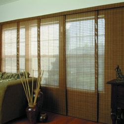 Woven Wood Sliding Panel - Rich in character, Natural Woods sliding panel shades carry the natural beauty of wood from your furniture to your window coverings. These earthy panel tracks are popular for large windows, walls of glass, patio sliders, sliding doors, or even as a room divider.
