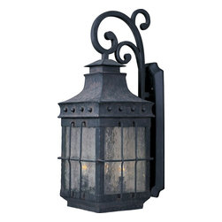 Maxim Lighting - Maxim Lighting Nantucket Forged Iron Traditional Outdoor Wall Sconce X-FCDC58003 - The Maxim Lighting Nantucket Forged Iron Traditional Outdoor Wall Sconce transports your home to the outdoor settings of early America. Constructed from robust Forged Iron, this light fixture features Seedy glass panels and a Country Forge finish, a reference to the Old World look. Wiry bars, knob accents, and a curling arm are defining decorative features exuding a timeless quality within this lighting fixture.