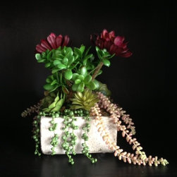 Succulent Centerpieces - Beautiful faux succulent centerpiece housed in a weathered concrete pot.   Arrangement by Johan Pulgarin at simple design ideas.  Email for sales information.