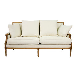 Kathy Kuo Home - St. Germain French Country Natural Oak Louis XVI White Sofa - Overstuffed cushions lend an informal touch to this elegant Louis XVI style sofa. Upholstered in natural linen, its natural oak frame and fluted legs are embellished with decorative carvings. Set of 4 pillows included (2 larger pillows not shown here).