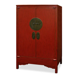 China Furniture and Arts - Elmwood Wedding Cabinet - In old China, a part of a bride's dowry was bed ware such as comforters and linens, which had been sent by the bride's parents in a cabinet such as this. Thus, the cabinet is known as the wedding cabinet. The symbol of unity and eternity represented in the circular shape is prevalent in Chinese custom as seen in the round brass doorplates. Made of Elmwood by artisan in China for long lasting durability. One removable shelf and two drawers inside for your convenience. Bottom shelf is removable to reveal a hidden compartment. Hand applied distressed red finish. Fully assembled.