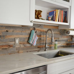 Wood back splash - This wood back splash offers the same advantages tiles offer - but no porcelain tile can compete with the look and the feel of this upcycled hardwood.
