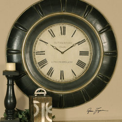 Rudy Clock - This clock features lightly distressed, rustic black with a gray glaze and antique gold accents. Quartz movement.