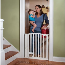 KidCo - KidCo Pinnacle Gateway Hands Free Pressure Mount Gate - White - G180 - Shop for Safety Gates from Hayneedle.com! The KidCo Pinnacle Gateway Hands Free Pressure Mount Gate - White is a smart and secure way to child-proof your home without getting yourself caught in the tangles. This heavy-duty steel gate features a secure pedal-operated opening system. Simply step on the pedal until you hear a click the locking indicator will turn green to let you know the gate is open push the gate open and step through. The auto-locking dual magnet gate closes itself and the indicator turns red to let you know the gate it closed. A two-way door allows for free usage and the smooth white finish easily blends with any existing decor.About KidCoIncorporated in 1992 KidCo specializes in the designing engineering and production of upscale products for juvenile pet and fireplace markets. The pressure-mounted safety gate was a completely new concept that put KidCo on the map and has since been the cornerstone of their business. KidCo offers a comprehensive assortment of child home safety products ranging from cabinet locks to TV straps and much much more. Located in Libertyville IL their state-of-the-art distribution and administration systems ensure that KidCo fulfills their customers' needs and expectations in an efficient and timely manner. Today KidCo personnel still personally ensure the highest level of customer service to both dealers and end consumers.