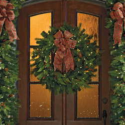 """Frontgate - 48"""" White Pine Cordless Christmas Wreath Christmas Decor - Boughs and berries perfectly mimic nature. Superbright, 5mm LED bulbs are energy efficient and long lasting. Convenient 6-hour timer. Optional manual switch located on the weatherproof battery box. Operates on D batteries (not included). Watch the Video Wispy cedar and Douglas fir branches and berries, along with pinecones and bright LED lights make our Winter Pine Cordless wreaths and garland truly shine. This lush greenery can be easily programmed to glow at the same time, every day of the week.  .  .  .  .  . Multi-colored lights are red, green, blue, gold, and purple. To maximize fullness, greenery will need to be shaped. Bows sold separately."""