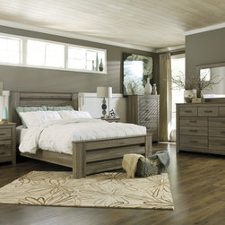 """Rustic/Reclaimed - Rustic beauty has never been brought to life more than with the warm relaxing design of the """"Zelen"""" 5-piece bedroom (dresser, mirror & queen poster bed). The warm gray finish features a stylish white wax effect beautifully complementing the replicated oak grain all surrounding the unique horizontal pocket details and wide pilasters adorning this rustic furniture."""