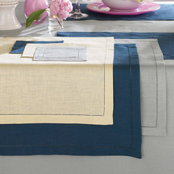 Frontgate - SFERRA Festival Set of 4 Placemats - 100% medium-weight linen. Placemats and napkins sold in sets of four. Find your size tablecloth with our measuring guide.. Machine wash gentle cycle with gentle detergent. Dinner and cocktail napkins come in non-monogrammed or monogrammed styles. Woven in Europe and sewn with an elegant hand thread-drawn hemstitched hem, our SFERRA Festival Table Linens come in a range of bold, luscious colors that are sure to complement your favorite dinnerware.  .  . .  . . Made in Italy by SFERRA. Please note: Personalized items are non-returnable.