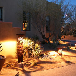 Attraction Lights overview - Tucson Parade of Homes model lighting.  Swirls 6x6 Bollard and 4x4 Path lights, natural rust finish.  Photo by Lyle Braund