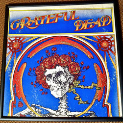 "Glittered Grateful Dead Record Album - Glittered record album. Album is framed in a black 12x12"" square frame with front and back cover and clips holding the record in place on the back. Album covers are original vintage covers."