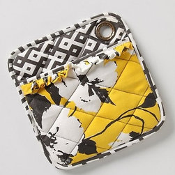 "Picking Pansies Potholder - I think a pair of these pot holders could be a fun eclectic addition to a retro kitchen — say, with black and white checkered floors.Dimensions: 8.75""L, 8.5""W. Made of cotton."