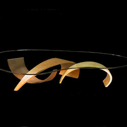 Ichthys Coffee Table - This is yet another variation of the Ichthys design, shown here as a coffee table with three crafted pieces for the base. As the other glass topped pieces, this allows for the beauty of the design to be appreciated no matter the placement or surroundings. It exhibits warmth and sophistication in a contemporary design with a feel of fluid movement.