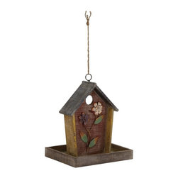 UMA Enterprises - UMA Enterprises Flowered House Bird Feeder Multicolor - 76199 - Shop for Feeders from Hayneedle.com! The UMA Enterprises Flowered House Bird Feeder will be the safe and comfortable haven your feathered friends need in addition to adding elegance to your garden decor. Made from quality wood and metal designed to withstand anything nature throws its way this bird house feeder is finished in distressed brown with painted applied flower design. A wide rim frame and a circular opening complete the pretty picture. Simply hang it in your yard to enjoy the company of your feathered friends all the year round.