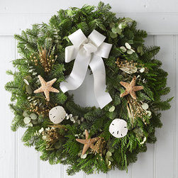 Coastal Evergreen Wreath - Christmas goes coastal with this beach-inspired wreath adorned with starfish and sand dollars.
