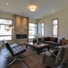 Contemporary Living Room by DEKORA Staging Inc