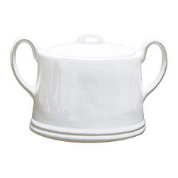 Clos du Manoir Sugar Jar - Wide at the base and narrowing toward the top where the urn-style arching handles meet the oval body, the Clos du Manoir Sugar Jar has just a hint of neoclassicism in its design to give a timeless air to this transitional serving piece. An attractive addition to this oval tea set, the piece is versatile enough to be paired with dinnerware or used to replace one of the most frequently-lost pieces from heirloom china sets.