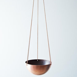 Copper Hanging Basket - How cool is this hanging copper bowl? I see it as a planter or fruit bowl in the most stylish of kitchens.