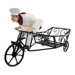 Bicycle Riding French Chef Wine Bottle Holder - This funny chef is making a special delivery, just for your favorite wine lover. Made of cold cast resin and metal, this decorative wine holder holds your favorite bottle of red or white. He measures 6 inches tall, 11 1/2 inches long , and 4 inches wide. This piece is hand-painted, from the checks on his apron to the red kerchief around his neck. He makes a great housewarming gift