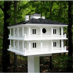 Home Bazaar Club House Birdhouse - Get your local avian friends ready for Kentucky Derby day with the southern plantation style of the Club House Birdhouse. Reflecting a distinctive American architecture, this birdhouse boasts wraparound porches and two separate nest boxes. 1.25-inch openings are perfect to accommodate wrens, chickadees, finches, and nuthatches. Constructed of exterior-grade plyboard, your birdhouse will be ready to meet the elements and the needs of your flock. A removable bottom makes cleaning simple.About Home BazaarCombining their love of birds and nature with their technical and design abilities, the people of Home Bazaar set out to create the world's most spectacular line of birdhouses and birdfeeders in 1999. They've even created a line of architectural birdhouses, feeders, pedestals, and garden accessories. These items are created using only the finest materials and with painstaking attention to detail. Each product is manufactured for functional use and to be enjoyed for years. Distinctive bird houses and feeders can be matched with accommodating pedestals and these pieces can be placed in the backyard or the garden. Cottage designs and pieces with Victorian scrollwork often end up on covered porches or inside the home as decorative accents.