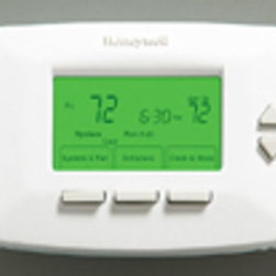 Honeywell Consumer Products - RTH6450D1009 PRG Thermo - Vision Programmable Thermostat Universal thermostat: conventional or heat pump 5-1-1 day programming - 4 daily periods Menu driven armchair programming Easy to read back-lit display (on demand) Filter change reminder and low battery indicator Precise temperature control +/- 1 degree Energy Star rated RTH6450D1009 PRG THERMO