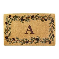 Creative Accents Heavy Duty Coir Mat Evergreen Border with Monogram - Show off your love of the beauty of evergreens with the Nedia Enterprises Heavy Duty Coir Mat Evergreen Border with Monogram. Crafted from naturally harvested coir fibers, this mat is hand woven using traditional looms and then sheared to create a dense pile that helps to clean shoes and trap dirt and moisture. It's hand-tufted fibers and heavy coir fiber backing also helps to keep the mat in place and locks the fibers in place to minimize shedding. Fade-resistant dyes are used so you can enjoy the vibrant colors and pattern for years. Coir is a renewable resource and the mat is completely biodegradable and compostable. Best used in sheltered areas, such as a covered porch, this mat can cause color transfer to natural stone, concrete, and other surfaces if it's excessively exposed to the elements. Naturally mold- and mildew-resistant, this gorgeous mat will have some slight variations in size, color, and texture, giving each mat its own unique characteristics. It's also normal for the mat to shed fibers during the first few weeks it's used. Optional monogramming is available. Additional Features Coir fibers are a renewable resource Mat is biodegradable and compostable Designs are hand stenciled on the mat Made with fade-resistant dyes Best used in sheltered areas Avoid exposure to extreme moisture and sunlight Excessive exposure can cause color transfer Variations in size, color, and texture are normal Mat will shed fibers the first few weeks Clean by occasionally giving a good shake Optional monogramming is available Can be used indoors or out