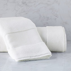 "Frontgate - Resort Cotton Hand Towel - Luxury bath towels are generously oversized in an array of vibrant colors. Long-staple Turkish cotton that is finely combed for a smooth, soft feel. 700 grams per square meter results in superior plushness and absorbency. ""Zero Twist"" process plumps and stabilizes the yarn while revealing more of the cotton fiber. Add a monogram to the elegant, 5"" wide dobby border; view font options. Softer and longer than towels found at many five-star hotels and spas, our Resort Cotton Towels are lofty, thick, and as luxurious as any in the world. These zero-twist towels are crafted from pure, 100% long-staple Turkish cotton woven to 700 gsm. The end result is luxuriant softness and absorbency that outperforms others..  . . Hand towels feature a 2""H monogram regardless of font style. View towel care instructions. Made in Turkey . Please note, personalized items are nonreturnable. Allow 3-5 additional days for delivery."