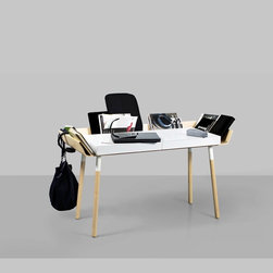 """My Writing Desk - This is a writing desk designed to reduce the difficulties of working in a mess. It has its storage space organised around the table top where all the things are always in sight and easily accessible. The desktop can be used right up to the edges without worrying that things might fall down, and any unnecessary objects can simply be pushed to the storage sides. The high edges of the desk isolates it in the room and creates a positive microclimate where things """"feel good"""" in relationship with the user.The wings are divided for simple construction leaving a path for the wires. There are two drawers for a laptop and writing equipment. The legs of the table can be twisted off for easier transportation."""