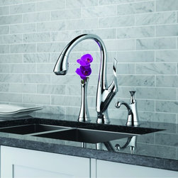 Belo Kitchen Collection By Brizo - A true work of art, Belo features a design as much sculpture as faucet. Its elegant, sweeping form is paired with a two-button, four-function pull-down wand that attaches with exclusive MagneDock® Technology.