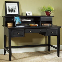 HomeStyles - 54 in. Executive Desk with Hutch - Desk with three drawers. Hutch with two drawers. Center drawer front is hinged and drops down to accommodate keyboard. Four open storage areas. Wire management opening. Brushed satin chrome hardware. Clear coat finish to help guard against wear and tear stemming from normal use. Made from Asian hardwood. Ebony finish. Desk: 54 in. W x 28 in. D x 30.25 in. H. Hutch: 54 in. W x 11 in. D x 9.75 in. H. Overall: 54 in. W x 28 in. D x 40 in. H. Desk Assembly Instructions. Hutch Assembly InstructionsThe Bedford Executive Desk and Hutch makes a wonderful addition to a room in need of extra workspace.