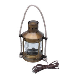 """Handcrafted Model Ships - Antique Brass Round Anchor Electric Lantern 16"""" - Nautical Decor - This antique brass anchor electric lantern 16"""" is a beautiful handcrafted production of heavy brass cast hardware. This lanterns provides fantastic emergency lighting or like their oil wick counterparts, these electric lanterns can provide historic and authentic nautical decor. There is a thick clear glass lens which shows an illuminated arc of 225 degrees. Each contains an interior corrugated silvered brass reflector. The oil burning pot and wick unit that was serviced from the bottom of the lanterns has now been converted into an electric fixture. There is room inside for a full size 25w light bulb. Some the applications that our electric lanterns have been used for include, wall lanterns, outdoor lanterns, ships wheel chandeliers, exterior lighting, ceiling fixtures and end table lamps. They also make perfect patio/deck electric lamps. You can also choose to mount them on your wall or post. The back is fitted with one thick cast brass mounting bracket which is riveted to the body of the lamp for extra support. All hardware is included. They are of solid brass construction, not to be confused with the cheaper painted or plated varieties. Ideal gifts for people who love nautical lamp memorabilia. Dimensions: 6"""" Long x 9"""" Wide x 16"""" High"""
