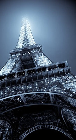 Eiffel Tower Artwork - Moody Blues. Le Tour Eiffel is the landmark of Paris. And this stunning photograph brings it alive with its shimmering lights and graceful arches. So real, you'll think you're standing there. Limited edition and signed by the artist.