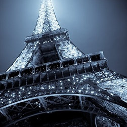 """""""Eiffel Tower"""" Artwork - Moody Blues. Le Tour Eiffel is the landmark of Paris. And this stunning photograph brings it alive with its shimmering lights and graceful arches. So real, you'll think you're standing there. Limited edition and signed by the artist."""