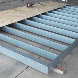 Temloc Building Photos - installation of the steel floor frame decking.