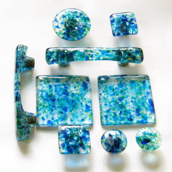 Handmade knobs, pulls, tiles and handles in a custom blend of cobalt blue, aqua, - Torch Lake is a signature blend of hand cut blue & green glass that is accented with dichroic sparkle.  It is available in 3 sizes of knob pulls, a handle and also custom tiles.  Carol Gilewicz of Torch Lake Glass
