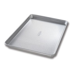 "USA Pans Half Sheet Pan 13 x 18 "" - The USA Pan Half Sheet Pan has been designed with many of the same standard features of industrial baking pans.  Each pan is constructed of aluminized steel  the material of choice for commercial bakeries.  Metal thicknesses have been selected that allow even heat distribution and maximum service life.  Our pans also use steel wires in the rim construction of most pans to provide additional strength and resist warping.  Each pan is coated with AMERICOAT� Plus  a proprietary silicone coating that nearly all North American bakers prefer over dark non-stick coatings.   AMERICOAT� Plus is a clear non-stick  environmentally friendly coating that is specifically formulated for superior baking and does not contain any PTFE��s or PFOA��s.  USA Pan bakeware features a corrugated  or fluted  design.  The corrugation maximizes pan strength and prevents warping  denting and other effects of everyday use.  Corrugation also minimizes surface contact with baked goods which translates into an evenly baked product that is easily released. USA Pan has been developed by the world's largest manufacturer of industrial bakeware and has been providing the world's leading commercial bakeries with the highest quality baking pans for over 50 years.  When you purchase a USA Pan you are buying products that meet industrial standards for innovation  quality and durability.  Put simply  our pans are the best available and are proudly produced in the UNITED STATES OF AMERICA. Product Features                                   Constructed of heavy gauge aluminized steel             Corrugated design allows for even baking            Proprietary AMERICOAT� coating allows easy release of food            Proudly made in the USA for over 50 years"