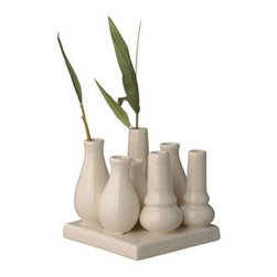In Bloom Bunch Vase - Go full bloom with this family of vases. Its neutral finish and clustering provide maximum impact for your favorite assortment of flowers, decorative accents, and more. From your dining room table to bathroom to living room, it will add versatile style wherever you place it.