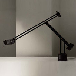 Artemide - Tizio Plus Table Lamp | Artemide - Design by Richard Sapper.The Tizio is a design classic, with the first version released in 1972.  It provides orientable halogen task lighting, and its elegant counterweight and arm system keep the head in a constant orientation.Features: